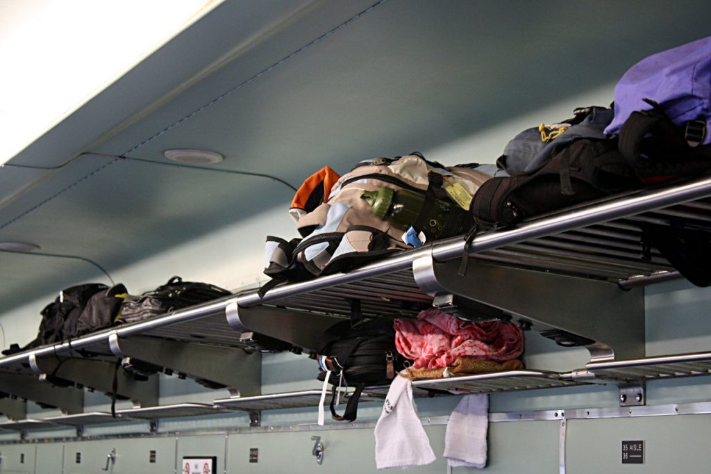 Image showing luggage is being placed on luggage portion in train