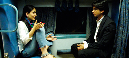 A lady talking to co passenger in train