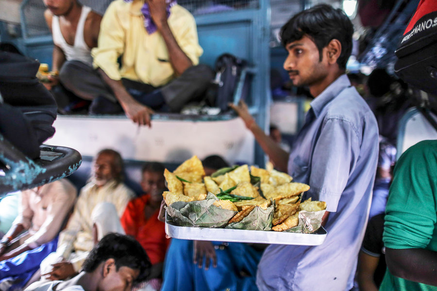 person selling samosa in train