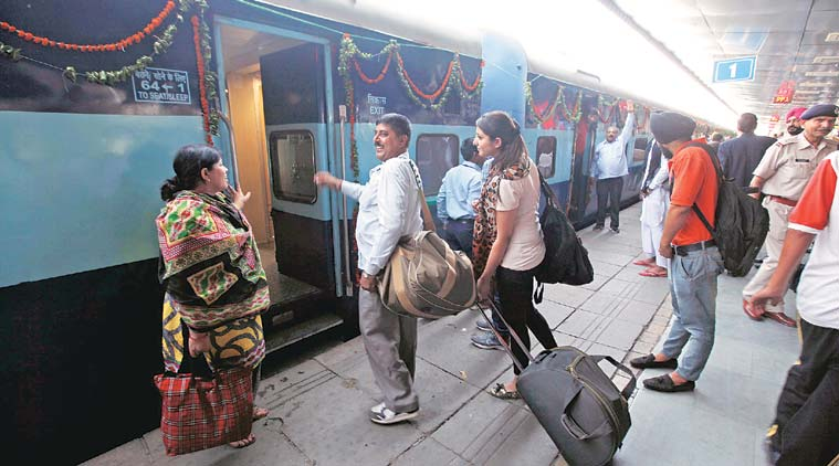 passengers at railways station-Omitra train travelers